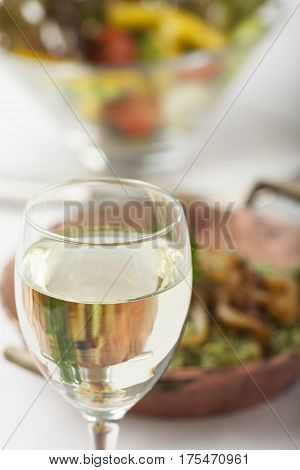 white wine and spinach spaetzle with salad