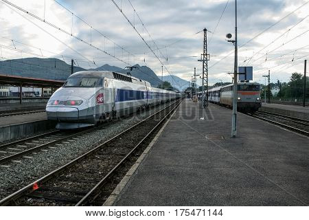 LOURDES FRANCE - AUGUST 22 2006: French High Speed train TGV Atlantique ready for departure on Lourdes station platform. Pyrennees mountains can be seen in the background
