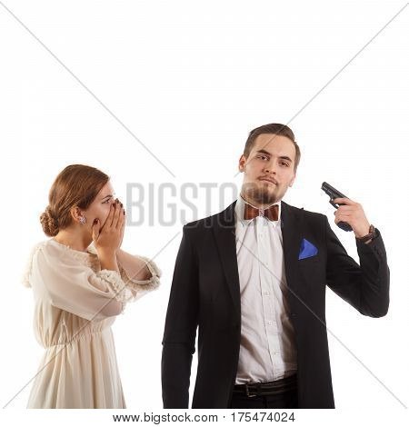 A man holding a gun to his head and a girl shocked by it