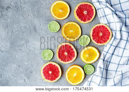 fruit design with cut blood orange and lime on gray stone table background top view mock-up