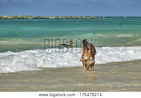Kailua, Hawaii, USA - August 1, 2026: Young women play on the shores of Kailua Beach