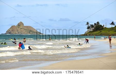 Kailua Hawaii USA - August 1 2026: Families and children play in the ocean shores of Hawaii