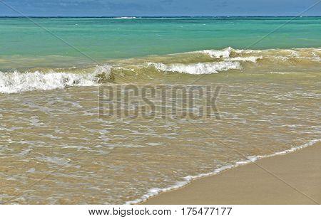 Ocean Surf And Waves On A Sandy Beach In Hawaii