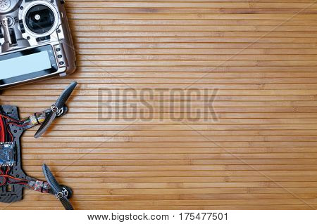 Remote And The Drone On Wooden Background