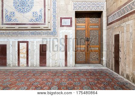 Cairo, Egypt - February 18, 2017: Interior of Al Rifaii Mosque (Royal Mosque) with decorated marble wall and ornate wooden door located in front the Cairo Citadel Egypt