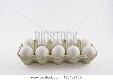Dozen white eggs in a box isolated.