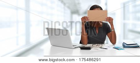 Business woman with cardboard on face