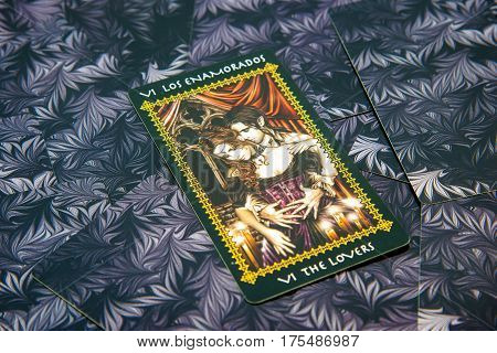 Moscow Russia - January 29 2017: Tarot card The Lovers. Favole tarot deck. Esoteric occult background