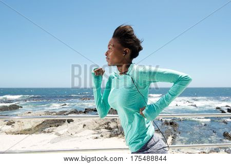 Active Young Black Woman Running By The Sea