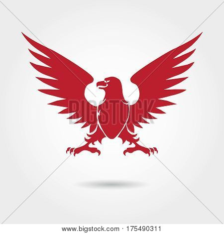 Red eagle heraldic style silhouette. Vector eagle logo design