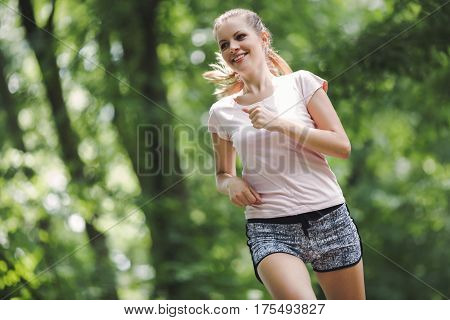 Beautiful Jogging Woman In Nature