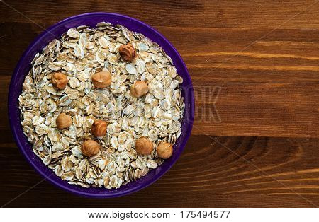 Oatmeal With Nuts Hazelnuts. Oatmeal  On A Wooden Background. Healthy Food