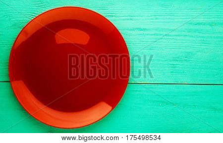 Plate On A Wooden Background.red Plate . Plate Top View. Copy Space