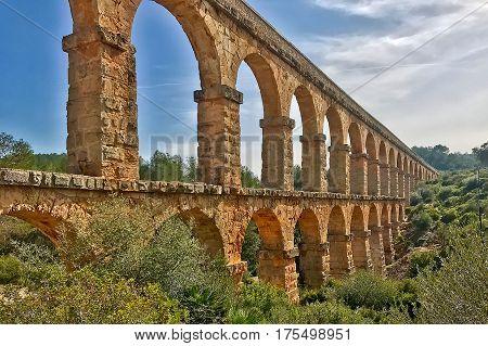 Tarragona, Spain, February 22, 2017: The Roman aqueduct at Tarragona in Spain.