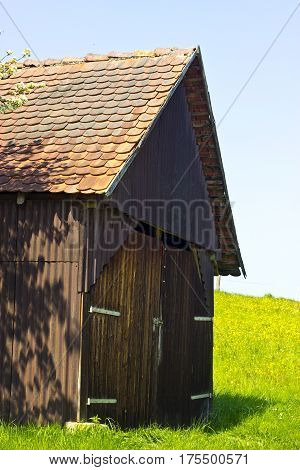 Picture of a idyllic Woodshed in Springtime