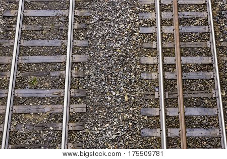 Two train tracks running side by side seen from above commuting concept transportation background