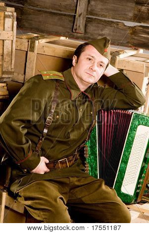 Soldier in historical soviet military uniform of World War II poster