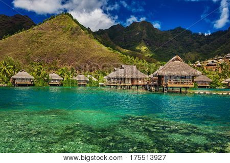 Tropical resort with over water bungalows on Moorea Island, French Polynesia