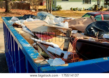 container Overflowing Dumpster being full with garbage