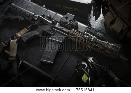 assault rifle ar15 and equipment in low loght