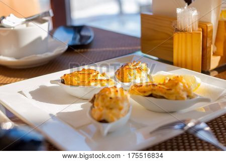 Baked mussels. Delicious seafood, New Zealand mussels baked with cheese  and lemon