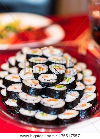 sushi roll food japanese rice asian salmon traditional plate raw fish maki cuisine fresh japan gourmet meal seafood dinner asia sashimi seaweed ginger delicious healthy closeup black prepared tuna white avocado nori diet dish cucumber red set eat