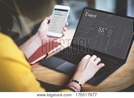 Woman checking appointment on personal organizer schedule