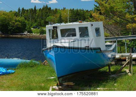 Small fishing boat up on the shore along the Nova Scotia coast.
