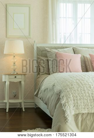 Luxury Bedroom Interior With Pink Pillows And Reading Lamp On Bedside Table