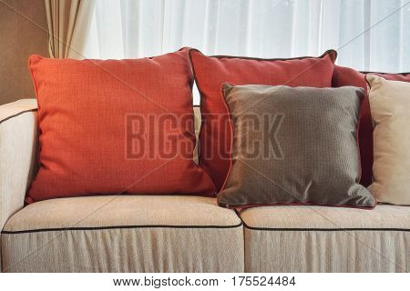 Red And Deep Brown Linen Pillows On Beige Linen Sofa In Modern Classic Living Room