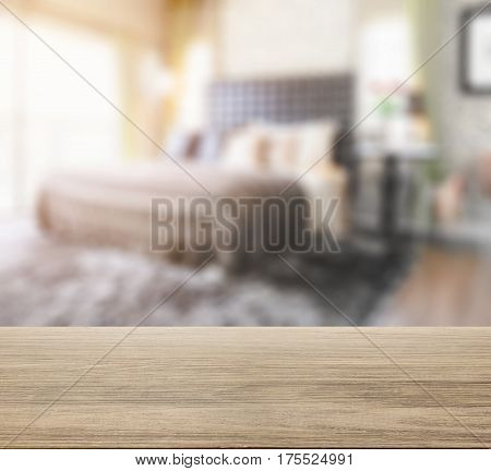Wooden Table Top With Blur Of Bedroom In Modern Interior Style