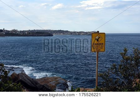 Sydney, Australia - Feb 5, 2017. Sign at the cliff's edge shows