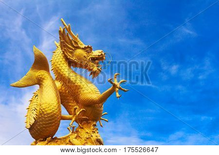Chinese dragon statue on  blue sky background.