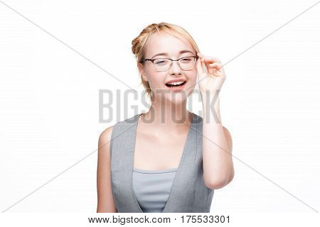 Happy and glad woman in glasses satisfied with life, isolated on white background. Optimistic smiling girl inspired by success.