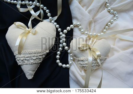 two vintage heart on a black and white background with pearls, wedding decor