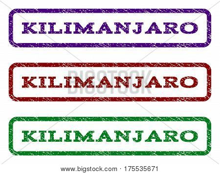 Kilimanjaro watermark stamp. Text tag inside rounded rectangle with grunge design style. Vector variants are indigo blue, red, green ink colors. Rubber seal stamp with scratched texture.