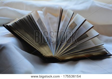 an open book lying on the table