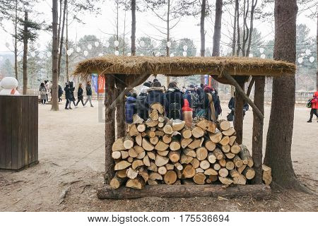 wood logs in shelter ready for flaming to keep people warm in winter taken at Nami island in Seoul Korea on 14 February 2017