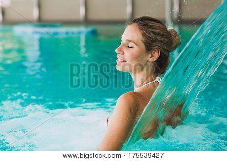 Beautiful Woman Enjoying Jet Of Water In Wellness Resort
