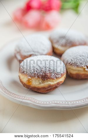 Jewish traditional home made holiday Hannukah doughnuts with sugar icing