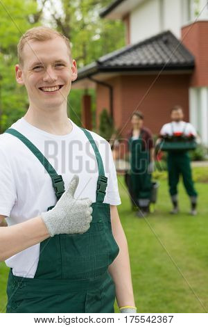 Smiling Gardener Standing With The Thumb Up