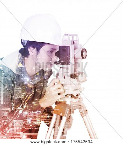 Double Exposure Of Engineer Working With Survey Equipment Theodolite On A Tripod Against The City Is