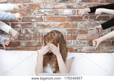 Ashamed Girl Surrounded By Hands