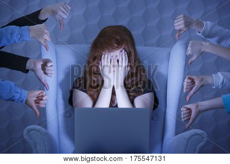 Girl With Laptop Covering Face