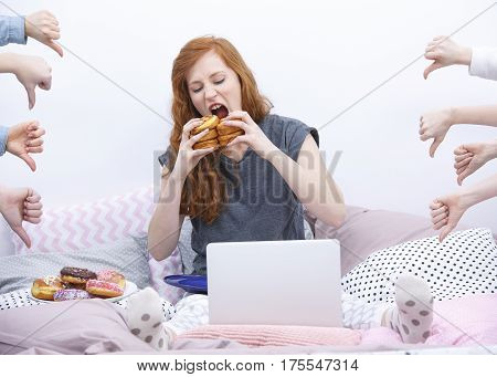 Girl Eating Donut On Bed