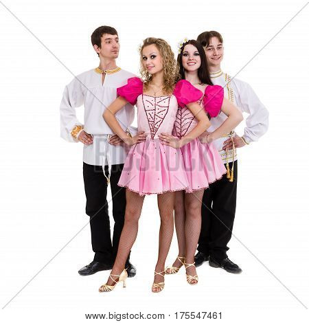 Dance team, two men and two women wearing a folk russian costume posing against isolated white background