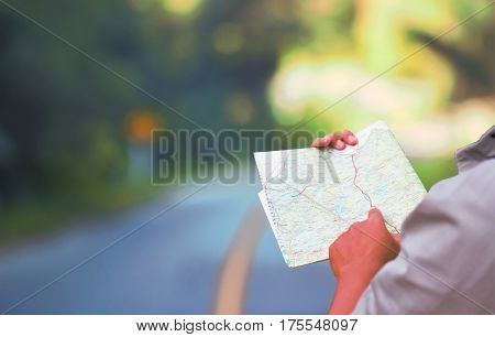 Man reading map soft blur for travel