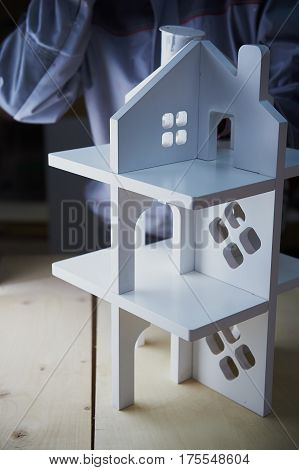 Painting white Dollhouse in the Studio. MDF