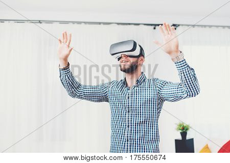 Attractive Guy Wearing State Of The Art Virtual Reality Goggles, Experiencing Digital Life