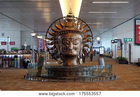 DELHI, INDIA - FEBRUARY 19: Surya, the resplendent one by Satish Gupta, golden statue in Airport of Delhi on February 19, 2016. Indira Gandhi International Airport is the 32th busiest in the world.